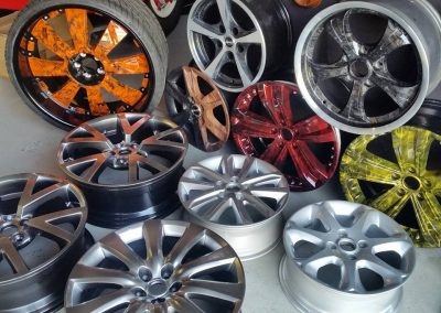 An assortment of rims done in Hydrographics designs along with silver and silver shadow chrome.