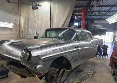 Closed door bare metal respray on a 1957 Buick Special during restoration.
