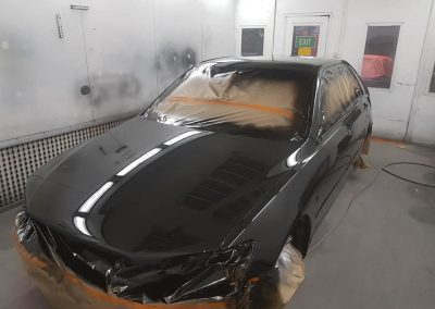 After shot of Lexus is200 painted in single stage PPG jet black.
