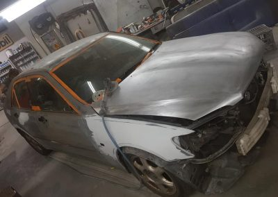 During shot of common paint fade and flaking paint on Lexus is200.