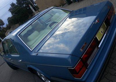 After shot of closed-door bare metal job on Bentley.