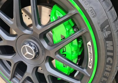 A Bright green colour match on Mercedes C63 brake callipers to match factory pin stripe around the rim.