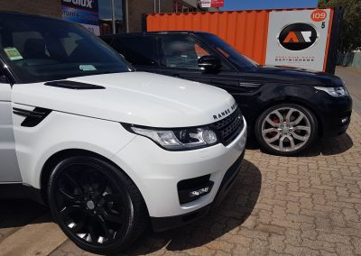 A blackout colour coding done on white Range Rover Sport including bonnet and guard vents, grille surround and rims.