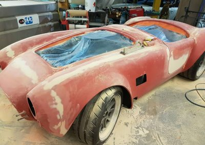 During shot of Shelby Cobra replica with prep work being done.