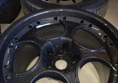 An example of two-piece Lamborghini wheels done in a standard carbon fibre print.